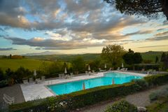 Beautiful evening in chianti near pool with great sky. Outstandinig evening with great coloured sky in chianti, Tuscany. Italy stock image