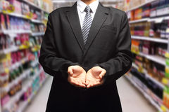 Outstretched cupped hands in supermarket in blurry Royalty Free Stock Photography