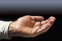 Outstretched hand. Hand outstretched for a handout or change Royalty Free Stock Image