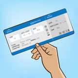 Outstretched hand with airplane ticket Stock Photos