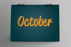 outubro escrito no calendário do Desktop Imagem de Stock Royalty Free