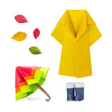 Outumn rain set. Origami paper umbrella multicolor with gumboots and raincoat set on a white background Royalty Free Stock Photos