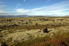 Outwash plain somewhere  in Iceland. Icelandic landscape with outwash plain and hills Royalty Free Stock Photos