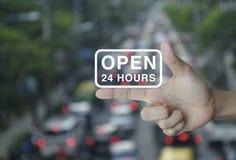 Ouvrez 24 heures d'icône sur le doigt, concept de commerce en ligne Image libre de droits
