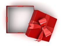 Ouvrez le boîte-cadeau rouge ou la boîte actuelle avec l'arc rouge de ruban et l'espace vide dans la boîte sur le fond blanc