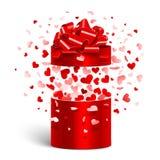 Ouvrez le cadeau avec des coeurs de vol Photo stock