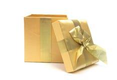 Ouvrez le cadeau d'or images stock