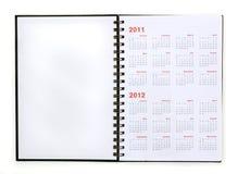 Ouvrez le carnet avec le calendrier 2011, 2012 Photographie stock libre de droits