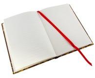 Ouvrez le livre avec le cahier rouge Photos stock