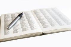Ouvrez le livre avec le crayon Photos libres de droits
