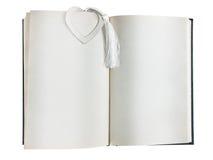 Ouvrez le livre avec le signet de coeur Photo stock