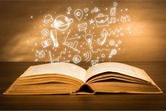Ouvrez le livre de Sainte Bible avec des icônes de griffonnage dessus Photos stock