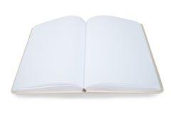 Ouvrez le livre sur un fond blanc Photographie stock libre de droits