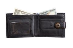 Ouvrez le portefeuille en cuir noir avec des dollars d'argent liquide Images libres de droits