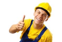 Ouvrier affichant le pouce vers le haut du signe Photo stock