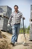 Ouvrier avec la cosse photo stock