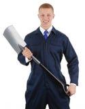 Ouvrier avec une cosse Photographie stock