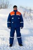 Ouvrier dans consister de procès de l'hiver photos stock