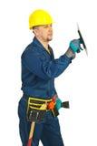Ouvrier de constructeur travaillant avec entaillé images libres de droits