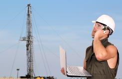 Ouvrier de pétrole Photo stock