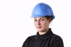 Ouvrier féminin avec le casque photographie stock