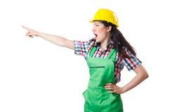 Ouvrier féminin dans des combinaisons vertes d'isolement sur le blanc Photographie stock libre de droits