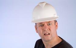 ouvrier grincheux de construction Images stock