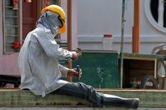 Ouvrier malaisien sous le soleil Photos stock