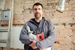 Ouvrier manuel de maçon d'homme de marteau de démolition Photos libres de droits