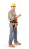 Ouvrier prenant des notes Photo stock
