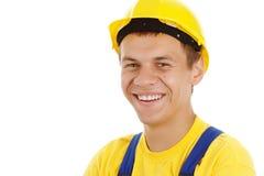 ouvrier s'usant heureux de casque antichoc Photographie stock libre de droits