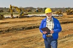 Ouvrier sur le chantier de construction Photographie stock