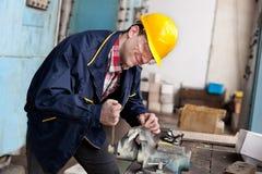 Ouvrier sur le travail Photo stock