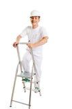 Ouvrier sur une échelle Photo stock