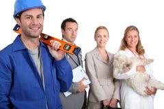 Ouvriers dans différents commerces Photo libre de droits