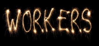 Ouvriers de mot écrits le sparkler Photo libre de droits