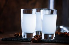 Ouzo - Greek anise brandy, traditional strong alcoholic drink in glasses on the old wooden table, place for text. Ouzo - Greek anise brandy, traditional strong royalty free stock images