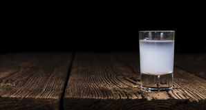 Ouzo in a shot glass Stock Photography