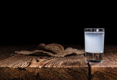 Ouzo on wooden background Royalty Free Stock Photos