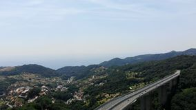 OVADA, ITALY - JULY 7, 2018: a large bridge, an autobahn , highway towering over a cliff, connecting two mountains. OVADA, ITALY - JULY 7, 2018: a large bridge stock video