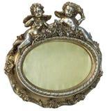 Oval barock guld- fhotoram med kupidonet på isolerad bakgrund royaltyfri bild