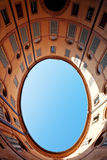 Oval blue sky in in Italian urban court Royalty Free Stock Photos