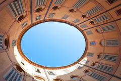 Oval blue sky in Italian urban court Royalty Free Stock Photos