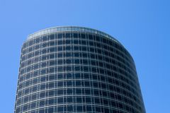 Oval Building. Oval contemporary office building or hotel against a blue sky Royalty Free Stock Image