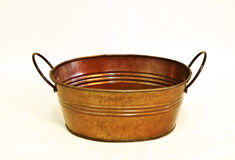 Oval Copper Bucket. Oval shaped copper plated bucket Royalty Free Stock Images