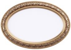 Oval förgylld bildram eller spegel som isoleras på wh Royaltyfria Foton