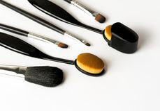 Oval foundation brush makeup with cover. Oval foundation brush make up with cover. Selective focus on white background. Brushes all in black color royalty free stock images