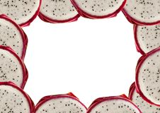 Oval frame folded round piece dragon fruit nut tainted exotic Asian. Natural fresh curb Royalty Free Stock Photo