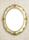 Oval golden color picture frame Stock Images