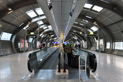 Oval hallway with moving walkways for passengers. royalty free stock photos